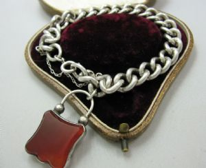 Superb Victorian silver curb bracelet with attached cornelian padlock